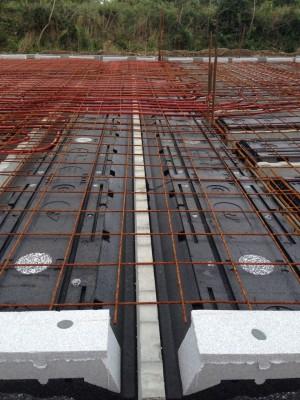 Plancher chauffant intégré à la dalle de compression
